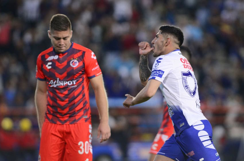 Victor Guzman celebrates after scoring his team's eighth goal against Veracruz on April 13, 2019. (Photo by Jaime Lopez/Jam Media/Getty Images)