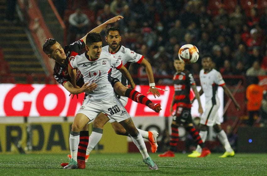 TIJUANA, MEXICO - APRIL 19: Jesus Angulo (L) of Tijuana fights for the ball with Enrique Torres (R) of Lobos BUAP during the 15th round match between Tijuana and Lobos BUAP as part of the Torneo Clausura 2019 Liga at Caliente Stadium on April 19, 2019 in Tijuana, Mexico. (Photo by Gonzalo Gonzalez/Jam Media/Getty Images)