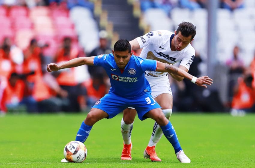 MEXICO CITY, MEXICO - APRIL 20: Orbelin Pineda of Cruz Azul fights for the ball with Alan Mozo of Pumas during the 15th round match between Cruz Azul and Pumas UNAM as part of the Torneo Clausura 2019 Liga MX at Azteca Stadium on April 20, 2019 in Mexico City, Mexico. (Photo by Mauricio Salas/Jam Media/Getty Images)