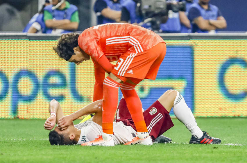 ARLINGTON, TX - JUNE 09: Mexico goalkeeper Guillermo Ochoa (13) checks on Mexico defender Hector Moreno (15) after getting kicked in the skin during the game on June 09, 2019 at AT&T Stadium in Arlington, Texas. (Photo by Matthew Pearce/Icon Sportswire via Getty Images)