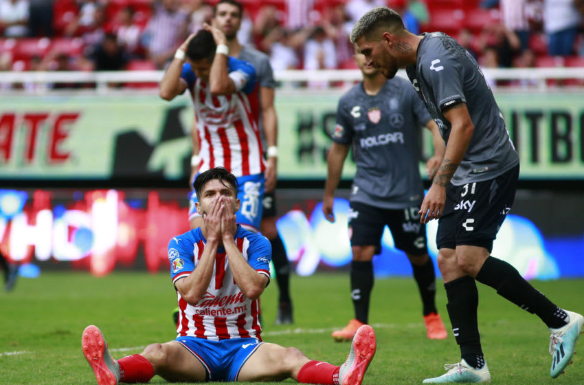 Veteran striker Oribe Peralta reacts after squandering a golden opportunity to score his first goal for the Chivas. (Photo by Alfredo Moya/Jam Media/Getty Images)