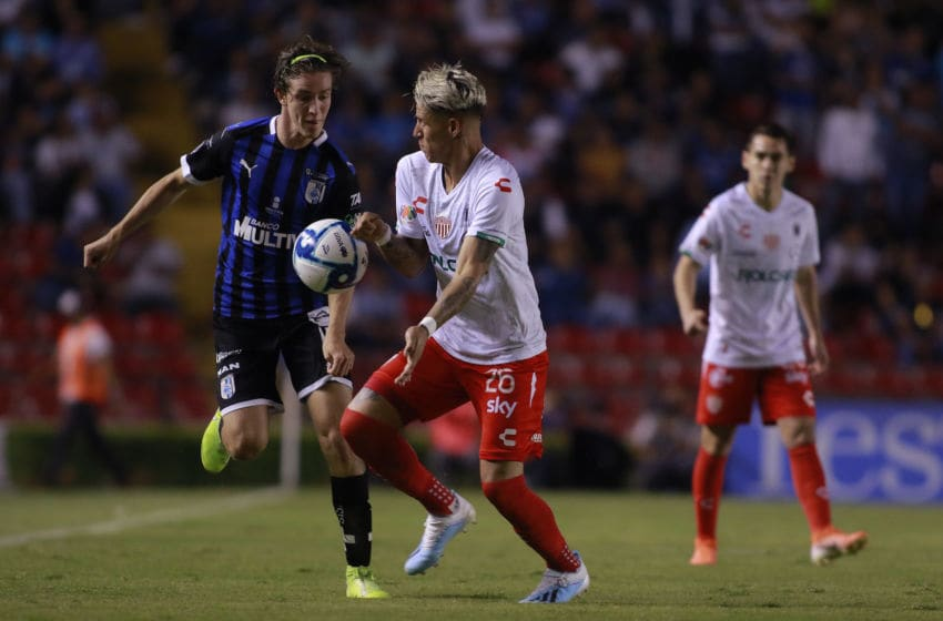 Marcel Ruiz (left) of Queretaro and Cristian Calderon of Necaxa compete for the ball during their Sept. 24 match won by the Rayos, 2-1. (Photo by Cesar Gomez/Jam Media/Getty Images)