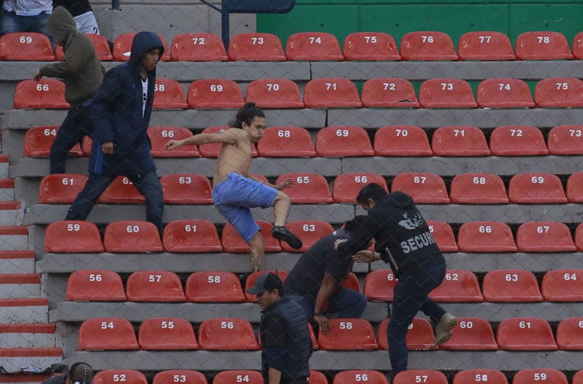 San Luis and Queretaro fans brawled in the stands at Estadio Alfonso Lastras in San Luis Potosí on Sunday. (Photo by Cesar Gomez/Jam Media/Getty Images)