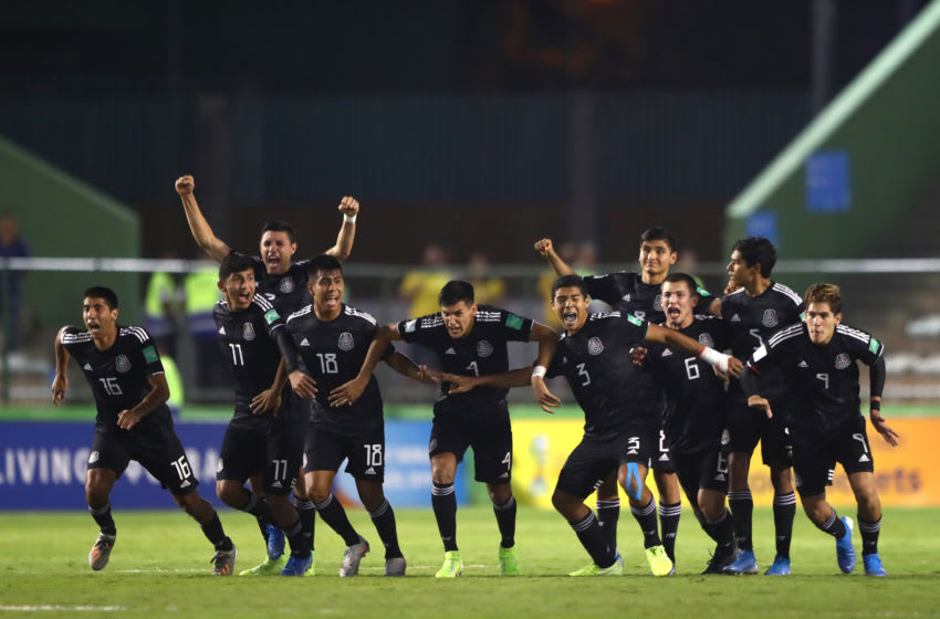 Mexico players celebrate their penalty shootout victory over Holland at the FIFA U-17 World Cup. (Photo by Martin Rose - FIFA/FIFA via Getty Images)