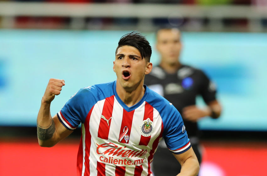 Alan Pulido celebrates after scoring his first goal against Veracruz. (Photo by Refugio Ruiz/Getty Images)