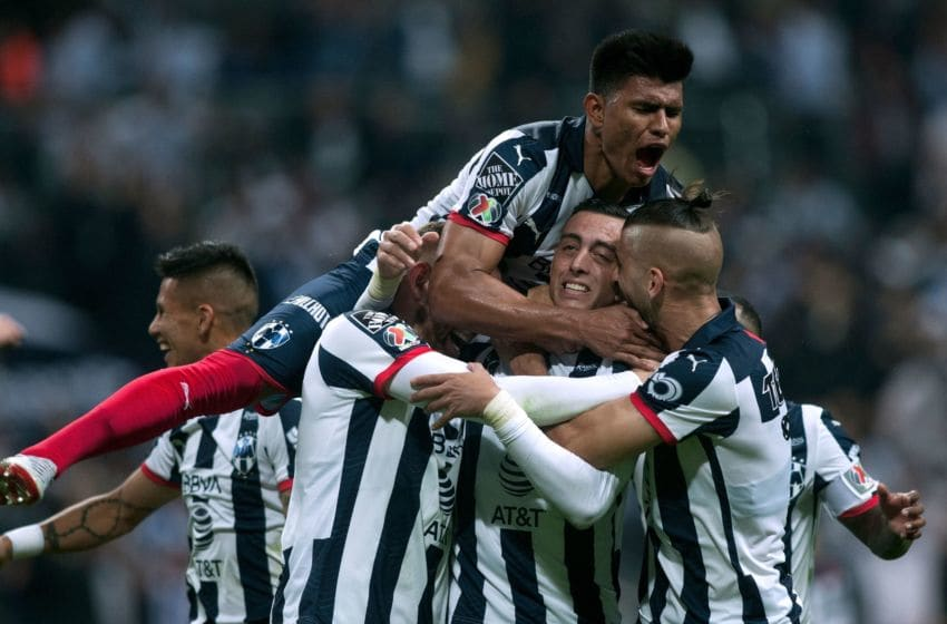 Monterrey players celebrate after Rogelio Funes Mori scored in minute 90+3 to give the Rayados a 2-1 lead heading into the second leg of the Liga MX Final against America . (Photo by JULIO CESAR AGUILAR/AFP via Getty Images)
