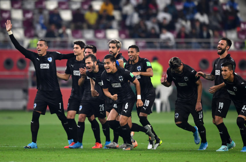 Monterrey players celebrate after Luis Cárdenas converted the winning penalty kick to claim third place in the FIFA Club World Cup. (Photo by Etsuo Hara/Getty Images)