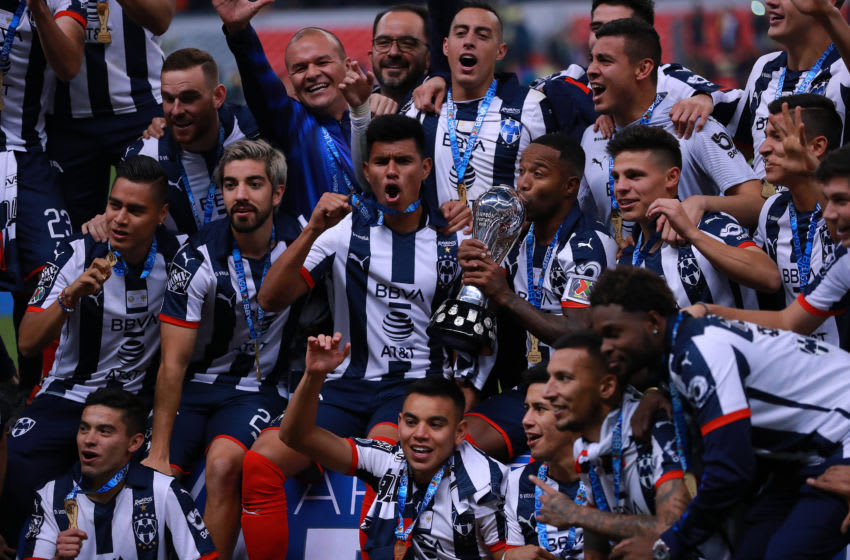 Monterrey players celebrate with the trophy after winning the Apertura 2019 title in a penalty shoot-out over América. (Photo by Manuel Velasquez/Getty Images)