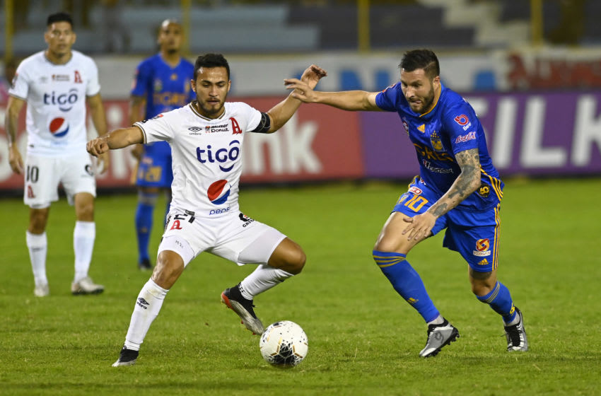 El Salvador's Alianza player Marvin Monterrosa (L) vies for the ball with of Mexico's Tigres player Andre Gignac (R) during their CONCACAF League football match at Cuscatlan Stadium in San Salvador on Febraury 19, 2020. (Photo by MARVIN RECINOS / AFP) (Photo by MARVIN RECINOS/AFP via Getty Images)