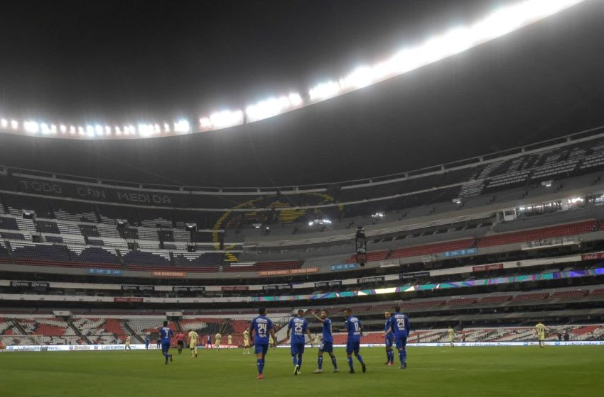 Cruz Azul's Uruguayan forward Jonathan Rodriguez (C) celebrates with teammates after scoring against America during their Mexican Clausura tournament football match at the Azteca stadium on March 15, 2020, in Mexico City. - The match is played without public as a preventive measure in the face of the global COVID-19 coronavirus pandemic. (Photo by PEDRO PARDO / AFP) (Photo by PEDRO PARDO/AFP via Getty Images)