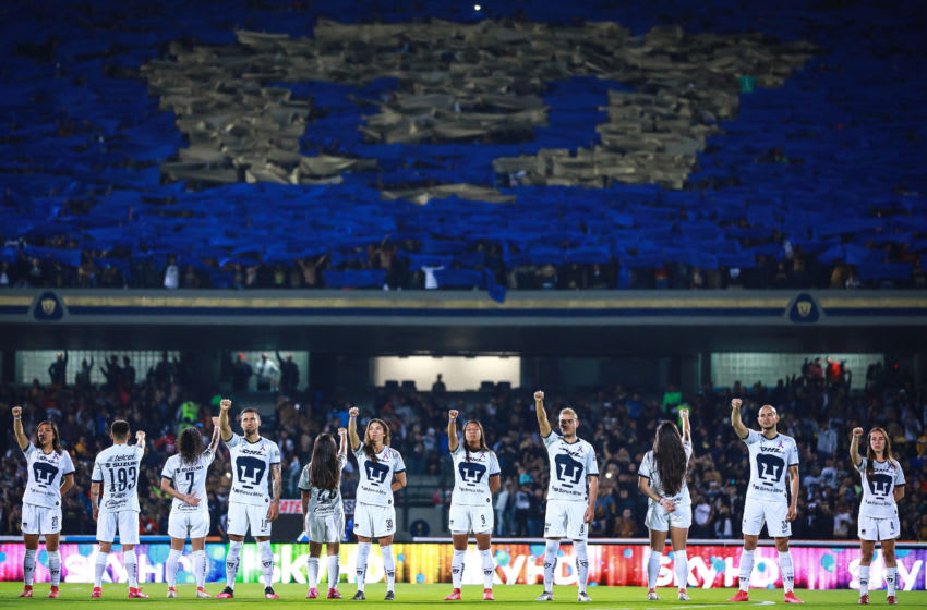MEXICO CITY, MEXICO - MARCH 06: Players of the womens team and mens team of Pumas sing the university hymn prior the 9th round match between Pumas UNAM and America as part of the Torneo Clausura 2020 Liga MX at Olimpico Universitario Stadium on March 06, 2020 in Mexico City, Mexico. (Photo by Manuel Velasquez/Getty Images)