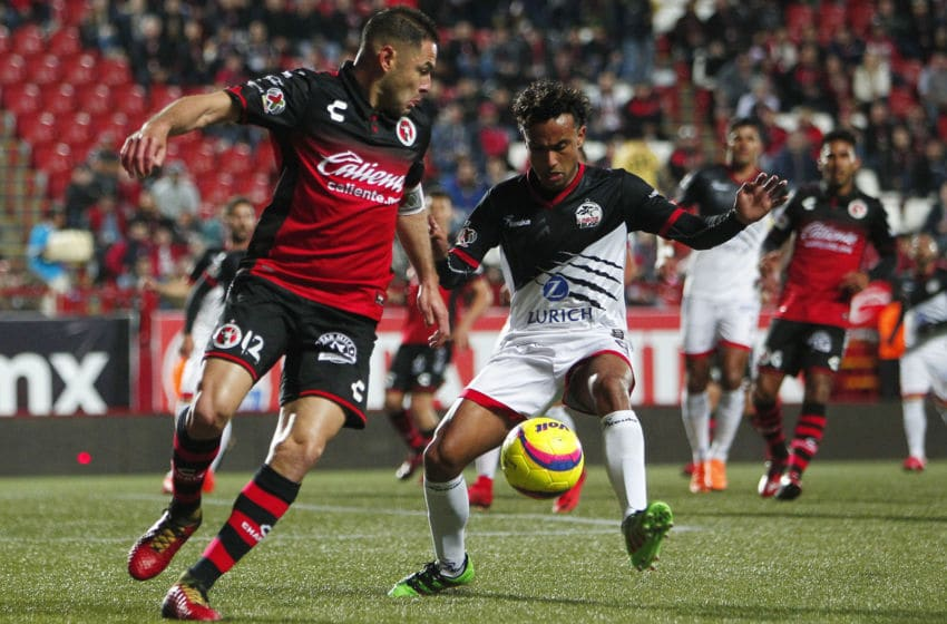 TIJUANA, MEXICO - MARCH 02: Pablo Aguilar (L) of Tijuana and Steeven Sierra (R) of Lobos BUAP fight for the ball during the 10th round match between Tijuana and Lobos BUAP as part of the Torneo Clausura 2018 Liga MX at Caliente Stadium on March 02, 2018 in Tijuana, Mexico. (Photo by Gonzalo Gonzalez/Jam Media/Getty Images)