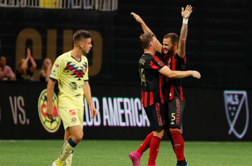 ATLANTA, GEORGIA - AUGUST 14: Leandro Gonzalez #5 and Julian Gressel #24 of Atlanta United celebrate winning the Campeones Cup between Club America and Atlanta United at Mercedes-Benz Stadium on August 14, 2019 in Atlanta, Georgia. (Photo by Kevin C. Cox/Getty Images)