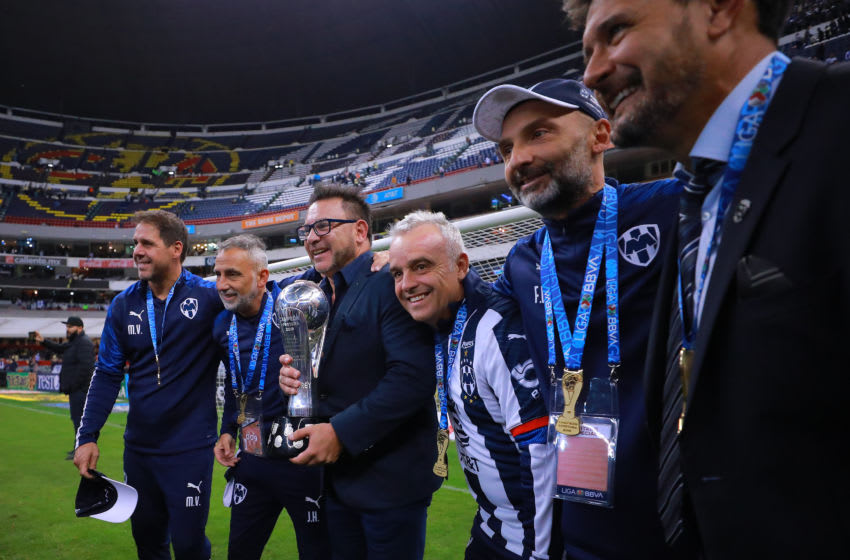 MEXICO CITY, MEXICO - DECEMBER 29: Antonio Mohamed, coach of Monterrey and his assistants celebrate with the Champion Trophy after the Final second leg match between America and Monterrey as part of the Torneo Apertura 2019 Liga MX at Azteca Stadium on December 29, 2019 in Mexico City, Mexico. (Photo by Manuel Velasquez/Getty Images)