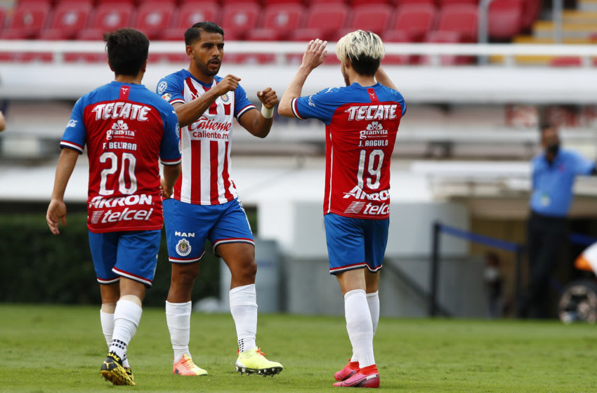 ZAPOPAN, MEXICO - JULY 11: Jesús Angulo #19 of Chivas celebrates with his teammates after scoring the first goal of his team during the match between Chivas and Mazataln FC as part of the friendly tournament Copa GNP por Mexico at Akron Stadium on July 11, 2020 in Zapopan, Mexico. (Photo by Refugio Ruiz/Getty Images)