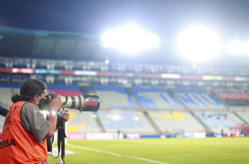 PACHUCA, MEXICO - JULY 27: Press photographer works with protective mask during the first round match between Pachuca and America as part of the Torneo Guard1anes 2020 Liga MX at Hidalgo Stadium on July 27, 2020 in Pachuca, Mexico. (Photo by Mauricio Salas/Jam Media/Getty Images)