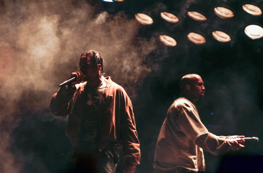LOS ANGELES, CA - AUGUST 22: Travis Scott performs with Kanye West at FYF Fest 2015 at LA Sports Arena