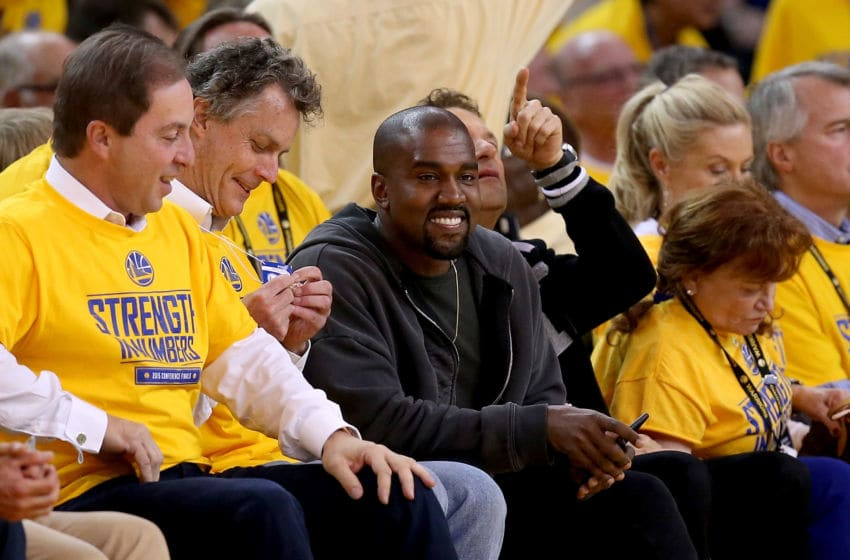 OAKLAND, CA - MAY 27: Rapper Kanye West sits courtside for game five of the Western Conference Finals of the 2015 NBA Playoffs at ORACLE Arena on May 27, 2015 in Oakland, California. NOTE TO USER: User expressly acknowledges and agrees that, by downloading and or using this photograph, user is consenting to the terms and conditions of Getty Images License Agreement. (Photo by Ezra Shaw/Getty Images)