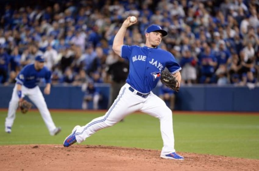 Oct 19, 2015; Toronto, Ontario, CAN; Toronto Blue Jays relief pitcher Liam Hendriks (31) throws against the Kansas City Royals during the ninth inning in game three of the ALCS at Rogers Centre. Mandatory Credit: Nick Turchiaro-USA TODAY Sports