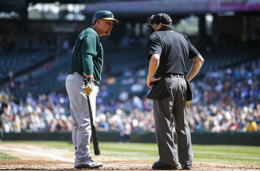 Aug 26, 2015; Seattle, WA, USA; Oakland Athletics designated hitter Billy Butler (16) speaks with home plate umpire Paul Schrieber (43) during a second inning at bat against the Seattle Mariners at Safeco Field. Mandatory Credit: Joe Nicholson-USA TODAY Sports
