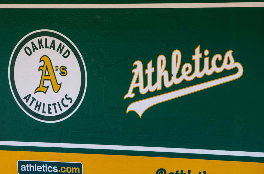 OAKLAND, CA - JULY 22: General view of the Oakland Athletics logos in the dugout before the game against the San Francisco Giants at the Oakland Coliseum on July 22, 2018 in Oakland, California. The Oakland Athletics defeated the San Francisco Giants 6-5 in 10 innings. (Photo by Jason O. Watson/Getty Images)