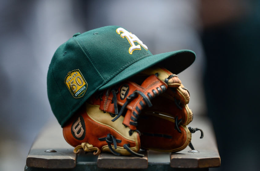 DENVER, CO - JULY 29: An Oakland Athletics player's hat and glove rests in the dugout during interleague play between the Colorado Rockies and the Oakland Athletics at Coors Field on July 29, 2018 in Denver, Colorado. (Photo by Dustin Bradford/Getty Images)