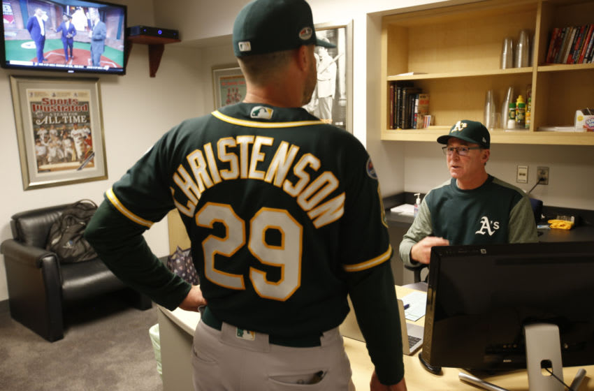 NEW YORK, NY - OCTOBER 3: Bench Coach Ryan Christenson #29 and Manager Bob Melvin #6 of the Oakland Athletics talk in the clubhouse prior to the game against the New York Yankees in the American League Wild Card Game at Yankee Stadium on October 3, 2018 New York, New York. The Yankees defeated the Athletics 7-2. Zagaris/Oakland Athletics/Getty Images)