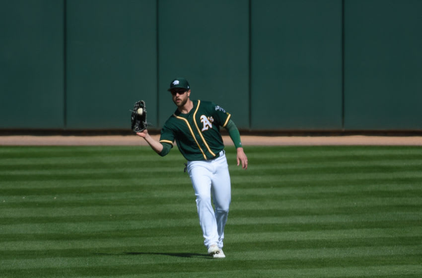MESA, ARIZONA - FEBRUARY 24: Dustin Fowler #11 of the Oakland Athletics catches a fly ball in the spring training game against the Kansas City Royals at HoHoKam Stadium on February 24, 2019 in Mesa, Arizona. (Photo by Jennifer Stewart/Getty Images)