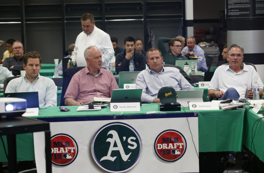Assistant General Manager Dan Kantrovitz, Adviser Sandy Alderson, General Manager David Forst and Executive Vice President of Baseball Operations Billy Beane of the Oakland Athletics sit in the Athletics draft room, during the opening day of the 2019 MLB draft, at the Oakland-Alameda County Coliseum on June 3, 2019 in Oakland, California. (Photo by Michael Zagaris/Oakland Athletics/Getty Images)