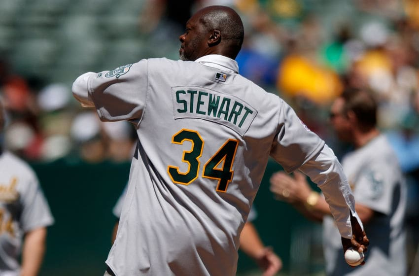 OAKLAND, CA - AUGUST 25: Former pitcher Dave Stewart of the Oakland Athletics throws out the ceremonial first pitch during a ceremony honoring the 1989 World Series championship team before the game against the San Francisco Giants at the RingCentral Coliseum on August 25, 2019 in Oakland, California. The San Francisco Giants defeated the Oakland Athletics 5-4. (Photo by Jason O. Watson/Getty Images)