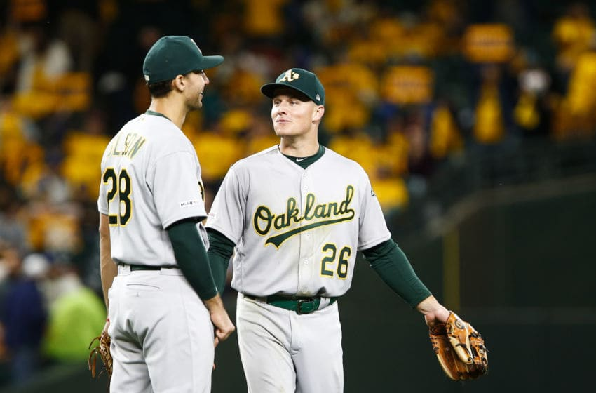 SEATTLE, WA - SEPTEMBER 26: Matt Olson #28 of the Oakland Athletics talks with Matt Chapman #26 as they celebrate their win over the Seattle Mariners at T-Mobile Park on September 26, 2019 in Seattle, Washington. The Oakland Athletics beat the Seattle Mariners 3-1. (Photo by Lindsey Wasson/Getty Images)