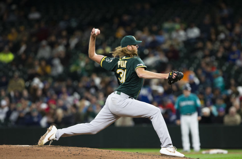 SEATTLE, WA - SEPTEMBER 27: A.J. Puk #31 of the Oakland Athletics pitches in the sixth inning against the Seattle Mariners at T-Mobile Park on September 27, 2019 in Seattle, Washington. (Photo by Lindsey Wasson/Getty Images)