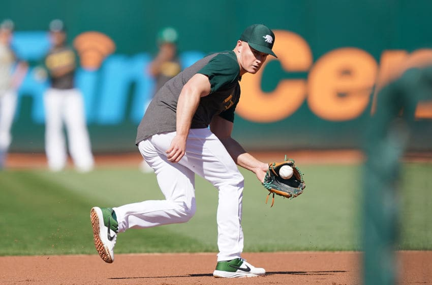 OAKLAND, CA - OCTOBER 02: Matt Chapman #26 of the Oakland Athletics fields ground balls during batting practice prior to the start of the American League WildCard Game against the Tampa Bay Rays at RingCentral Coliseum on October 2, 2019 in Oakland, California. (Photo by Thearon W. Henderson/Getty Images)