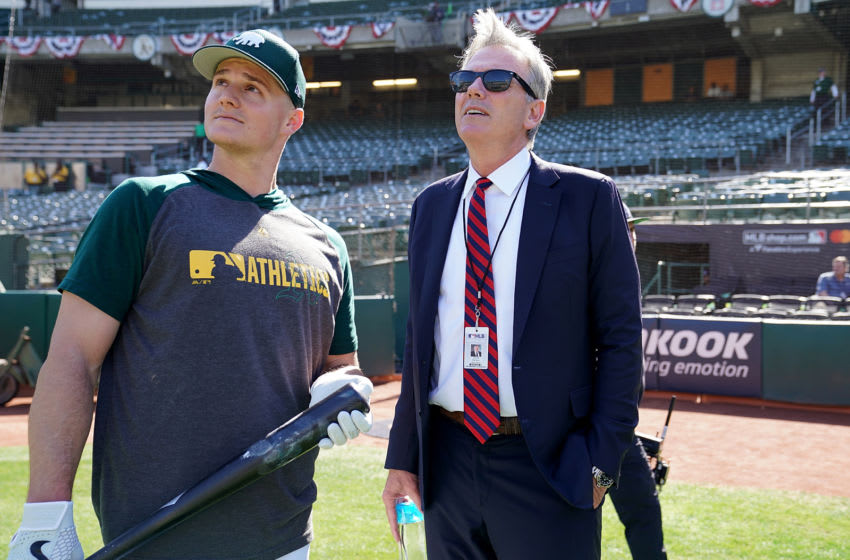 OAKLAND, CA - OCTOBER 02: Matt Chapman #26 of the Oakland Athletics (L) and General Manager Billy Beane (R) talk during batting practice prior to the start of the American League WildCard Game against the Tampa Bay Rays RingCentral Coliseum on October 2, 2019 in Oakland, California. (Photo by Thearon W. Henderson/Getty Images)