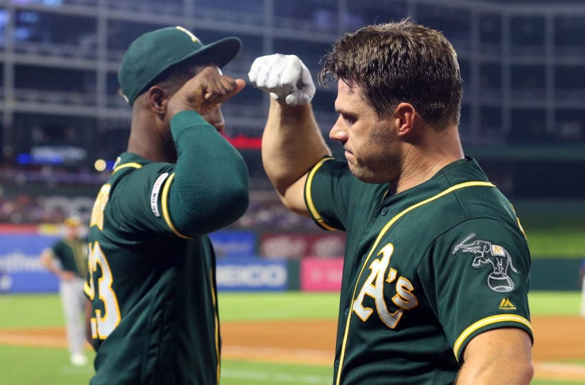 ARLINGTON, TEXAS - SEPTEMBER 14: Jurickson Profar #23 bumps elbows with Josh Phegley #19 of the Oakland Athletics after Phegley's two-run home run to take the lead in the fourth inning against the Texas Rangers at Globe Life Park in Arlington on September 14, 2019 in Arlington, Texas. (Photo by Richard Rodriguez/Getty Images)