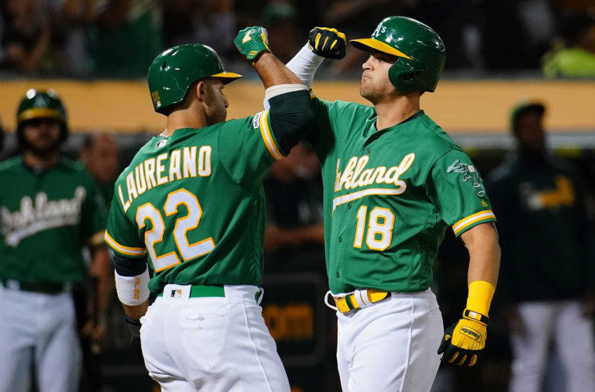 OAKLAND, CALIFORNIA - SEPTEMBER 20: Chad Pinder #18 of the Oakland Athletics celebrates a three run home run with Ramon Laureano #22 during the second inning against the Texas Rangers at Ring Central Coliseum on September 20, 2019 in Oakland, California. (Photo by Daniel Shirey/Getty Images)
