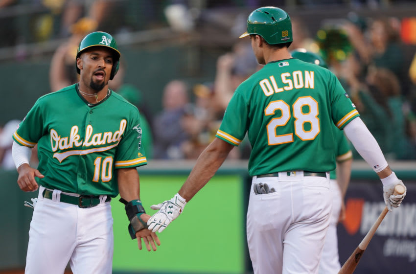 OAKLAND, CALIFORNIA - OCTOBER 02: Marcus Semien #10 of the Oakland Athletics celebrates with Matt Olson #28 after scoring on a sacrifice fly by Ramon Laureano #22 in the third inning of the American League Wild Card Game against the Tampa Bay Rays at RingCentral Coliseum on October 02, 2019 in Oakland, California. (Photo by Thearon W. Henderson/Getty Images)