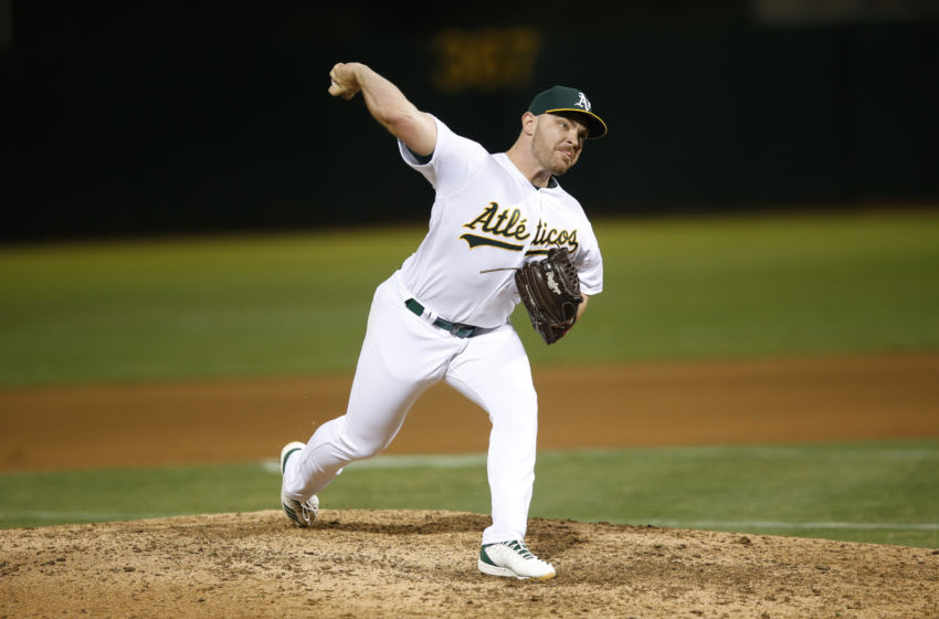 OAKLAND, CA - SEPTEMBER 16: Liam Hendriks #16 of the Oakland Athletics pitches during the game against the Kansas City Royals at the Oakland-Alameda County Coliseum on September 16, 2019 in Oakland, California. The Royals defeated the Athletics 6-5. (Photo by Michael Zagaris/Oakland Athletics/Getty Images)