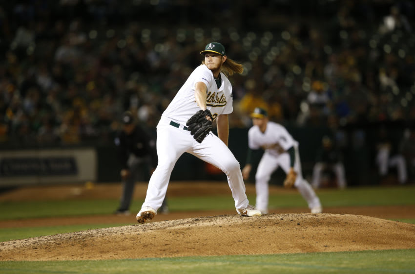 OAKLAND, CA - SEPTEMBER 17: A.J. Puk #31 of the Oakland Athletics pitches during the game against the Kansas City Royals at the Oakland-Alameda County Coliseum on September 17, 2019 in Oakland, California. The Athletics defeated the Royals 2-1. (Photo by Michael Zagaris/Oakland Athletics/Getty Images)