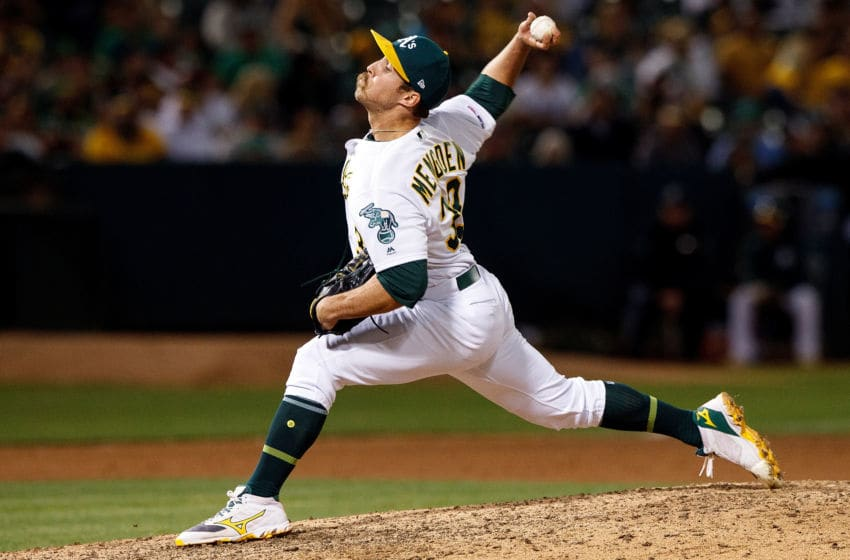 OAKLAND, CA - SEPTEMBER 21: Daniel Mengden #33 of the Oakland Athletics pitches against the Texas Rangers during the ninth inning at the RingCentral Coliseum on September 21, 2019 in Oakland, California. The Oakland Athletics defeated the Texas Rangers 12-3. (Photo by Jason O. Watson/Getty Images)