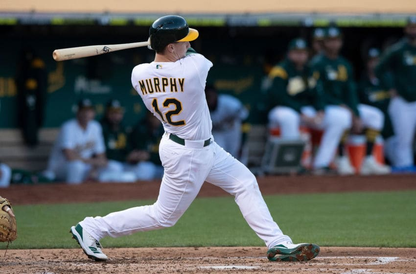 OAKLAND, CA - SEPTEMBER 07: Sean Murphy #12 of the Oakland Athletics at bat against the Detroit Tigers during the second inning at the RingCentral Coliseum on September 7, 2019 in Oakland, California. The Oakland Athletics defeated the Detroit Tigers 10-2. (Photo by Jason O. Watson/Getty Images)