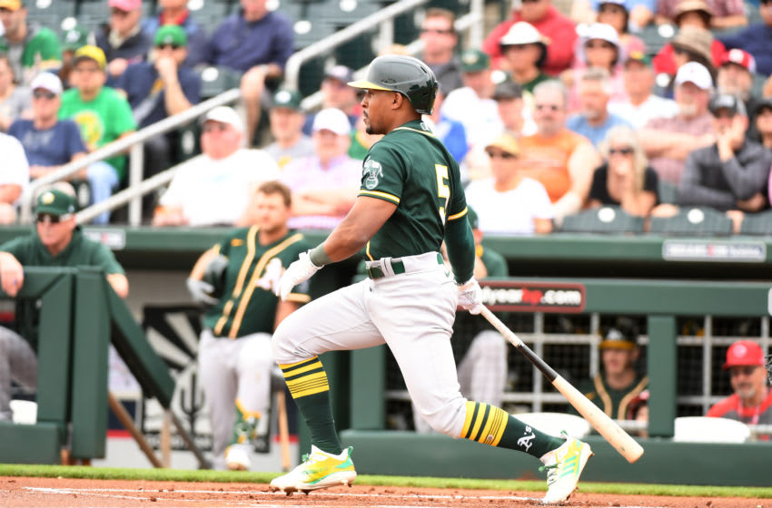 GOODYEAR, ARIZONA - FEBRUARY 28: Tony Kemp #5 of the Oakland Athletics follows through on a swing against the Cincinnati Reds during a spring training game at Goodyear Ballpark on February 28, 2020 in Goodyear, Arizona. (Photo by Norm Hall/Getty Images)
