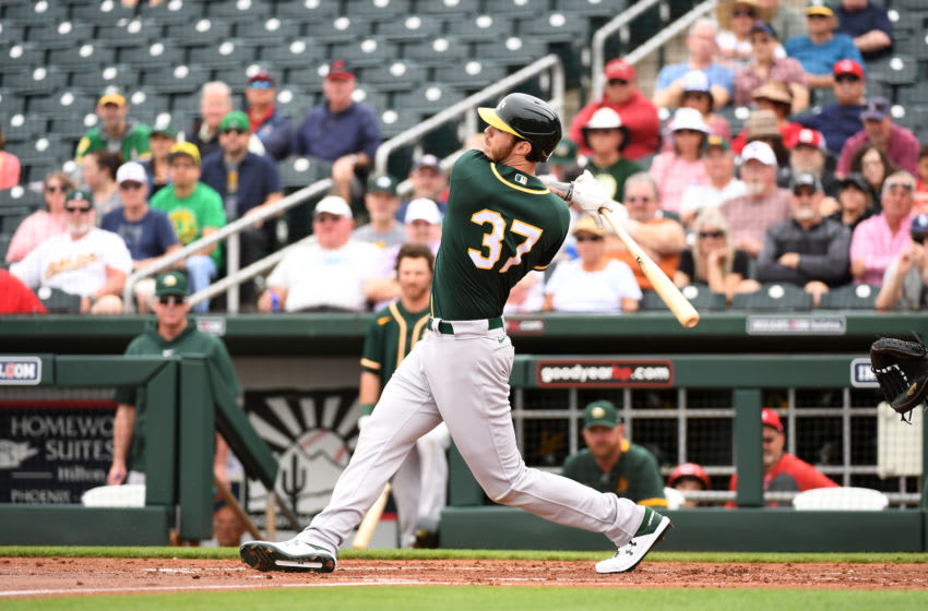 GOODYEAR, ARIZONA - FEBRUARY 28: Jonah Heim #37 of the Oakland Athletics follows through on a swing against the Cincinnati Reds during a spring training game at Goodyear Ballpark on February 28, 2020 in Goodyear, Arizona. (Photo by Norm Hall/Getty Images)