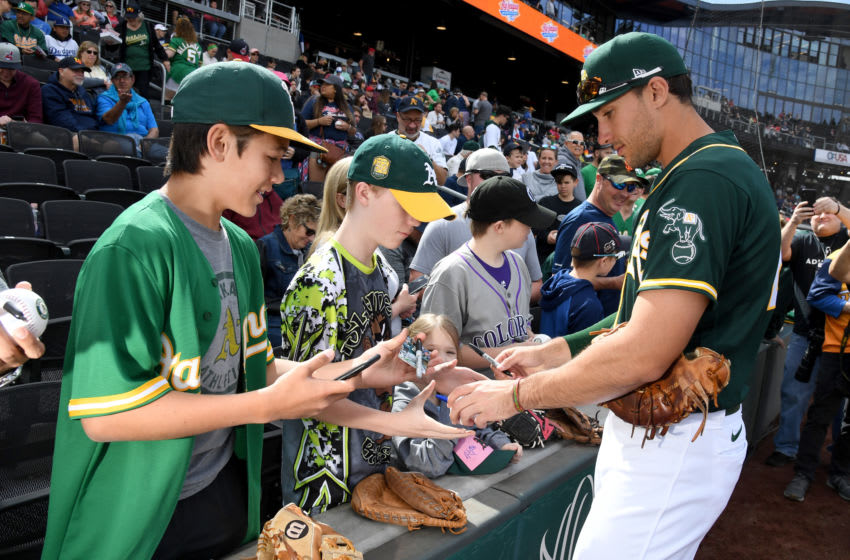 LAS VEGAS, NEVADA - FEBRUARY 29: Matt Olson #28 of the Oakland Athletics signs autographs for fans before an exhibition game against the Cleveland Indians at Las Vegas Ballpark on February 29, 2020 in Las Vegas, Nevada. The Athletics defeated the Indians 8-6. (Photo by Ethan Miller/Getty Images)
