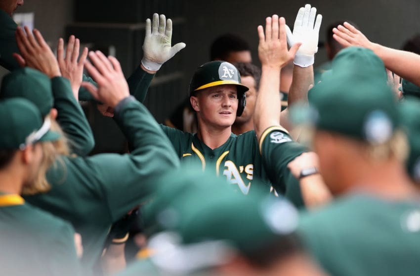MESA, ARIZONA - MARCH 10: Matt Chapman #26 of the Oakland Athletics high fives teammates in the dugout after scoring a run against the Kansas City Royals during the first inning of the MLB spring training game at HoHoKam Stadium on March 10, 2020 in Mesa, Arizona. (Photo by Christian Petersen/Getty Images)