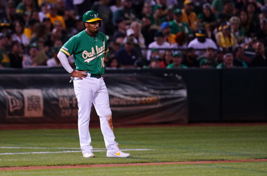 OAKLAND, CALIFORNIA - SEPTEMBER 20: Marcus Semien #10 of the Oakland Athletics takes a lead at third base during the game against the Texas Rangers at Ring Central Coliseum on September 20, 2019 in Oakland, California. (Photo by Daniel Shirey/Getty Images)