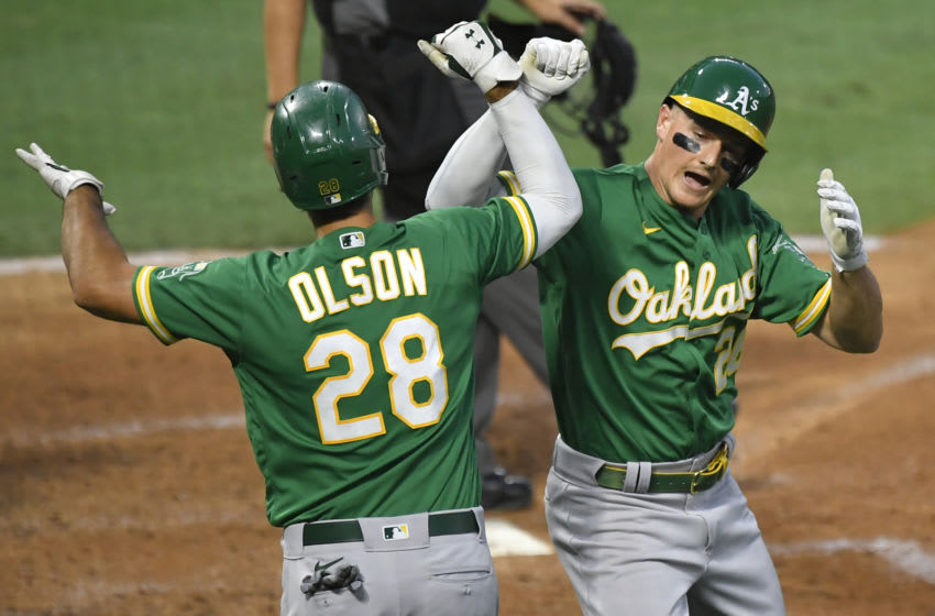 ANAHEIM, CA - AUGUST 10: Matt Olson #28 of the Oakland Athletics congratulates Matt Chapman #26 on his two-run home run against the Los Angeles Angels in the third inning at Angel Stadium of Anaheim on August 10, 2020 in Anaheim, California. (Photo by John McCoy/Getty Images)