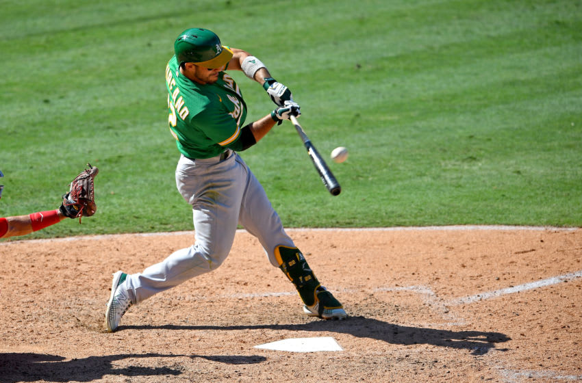 ANAHEIM, CA - AUGUST 12: Ramon Laureano #22 of the Oakland Athletics singles in two runs in the eighth inning of the game against the Los Angeles Angels at Angel Stadium of Anaheim on August 12, 2020 in Anaheim, California. (Photo by Jayne Kamin-Oncea/Getty Images)