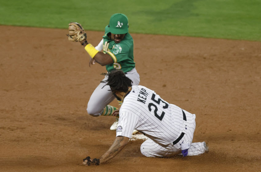 DENVER, CO - SEPTEMBER 15: Matt Kemp #25 of the Colorado Rockies slides safely into second base ahead of the tag by Tony Kemp #5 of the Oakland Athletics during the seventh inning at Coors Field on September 15, 2020 in Denver, Colorado. (Photo by Justin Edmonds/Getty Images)