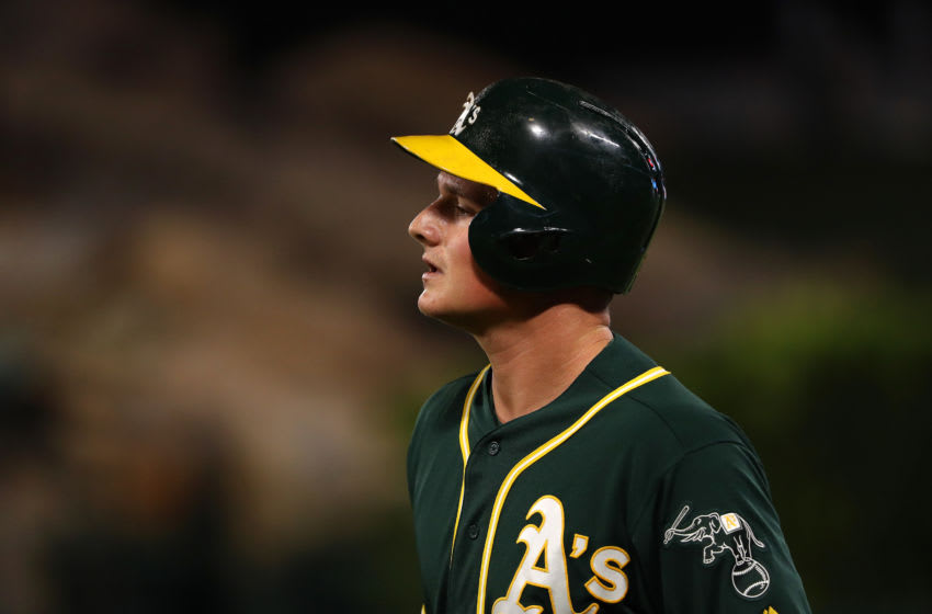 ANAHEIM, CALIFORNIA - SEPTEMBER 24: Matt Chapman #26 of the Oakland Athletics reacts after running to first base during the first inning of the MLB game against the Los Angeles Angels at Angel Stadium of Anaheim on September 24, 2019 in Anaheim, California. The Angels defeated the Athletics 3-2. (Photo by Victor Decolongon/Getty Images)